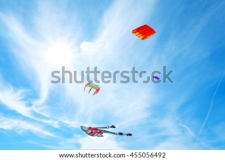 Kites , sun and blue sky in Sea front at Morecambe Lancashire , England , UK , Europe