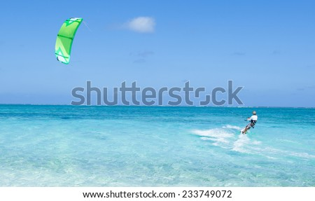 Kitesurfer in action on clear blue tropical water, Kume Island, Okinawa, Japan - stock photo