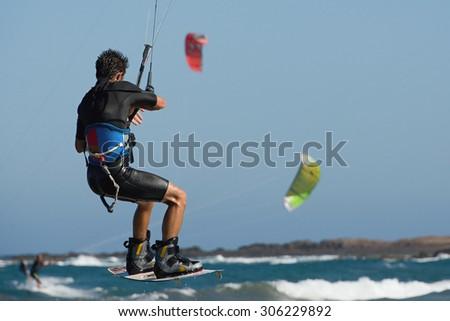 Kitesurfer jumping on a beautiful background - stock photo