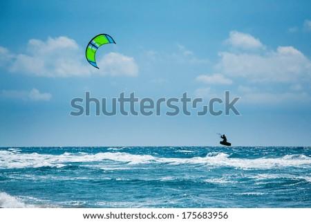 Kitesurfing or Kiteboarding - stock photo