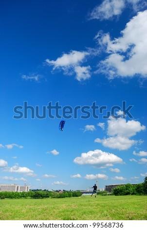 Kiting in park - stock photo