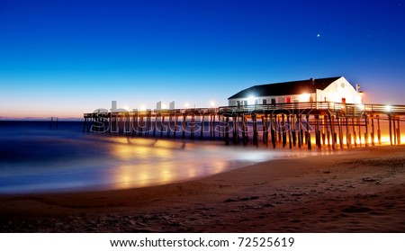 Kitty Hawk Pier Sunrise in the Outer Banks - stock photo