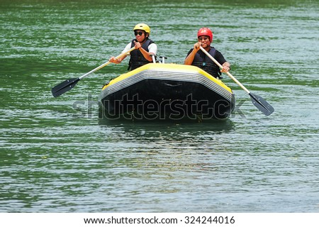 Kiulu Sabah Malaysia - June 7, 2015.Group of adventurer doing white water rafting activity at Kiulu river Sabah Malaysian Borneo on June 7, 2015.The river is popular for its scenic nature view.