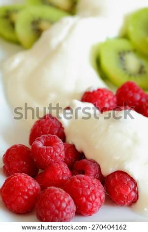 kiwi and raspberries with yogurt - stock photo