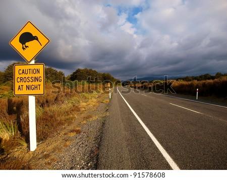 Kiwi crossing road sign - stock photo
