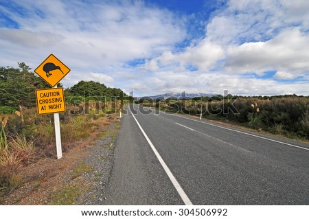 Kiwi crossing road sign in New Zealand - stock photo