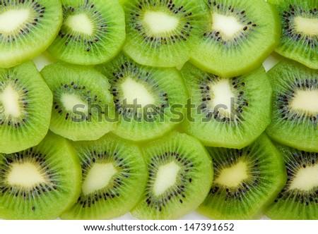 Kiwi cut circles stacked background - stock photo