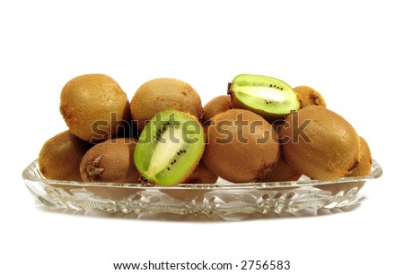 kiwi in plate over white background - stock photo
