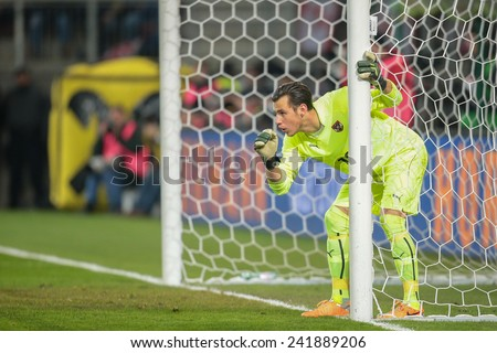 KLAGENFURT, AUSTRIA - MARCH 05, 2014: Heinz Lindner (#12 Austria) directs his defense in a friendly soccer game between Austria and Uruguay. - stock photo
