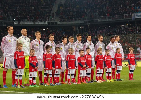KLAGENFURT, AUSTRIA - MARCH 05, 2014: The Austrian team poses before a friendly soccer game between Austria and Uruguay. - stock photo