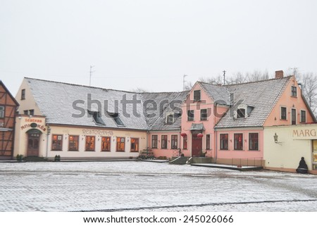 KLAIPEDA, LITHUANIA - JANUARY 9, 2013: Street in center of Klaipeda at cloudy winter day.