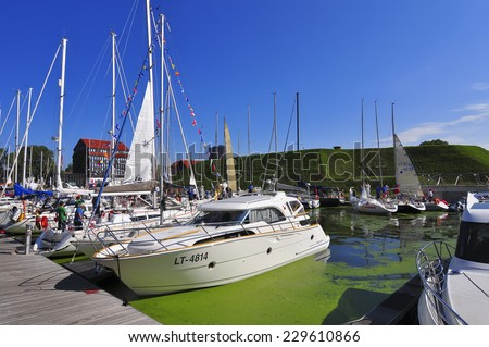 KLAIPEDA,LITHUANIA-JULY 31:Sailing boats in the harbor at summer on July 31,2011 in Klaipeda,Lithuania. - stock photo