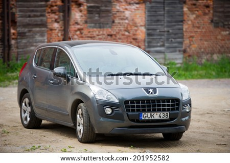 KLAIPEDA, LITHUANIA - JUN 16: Peugeot 3008 parked up in old town on June 16, 2014 in Klaipeda, Lithuania. The Peugeot 3008 is a compact crossover unveiled by French automaker Peugeot in May 2009.