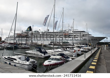 KLAIPEDA,LITHUANIA- JUNE 27:Sailing boats and cruise liner in the harbor at summer on June 27,2012 in Klaipeda,Lithuania.is the third largest city in Lithuania and the capital of Klaip?da County. - stock photo