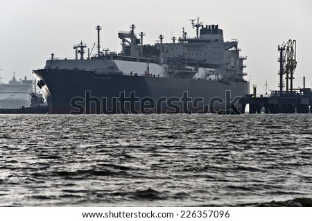 KLAIPEDA,LITHUANIA-OCT 27:The liquefied-natural-gas (LNG) ship Independence in Klaipeda port in very cloudy and foggy day on October 27,2014 in Klaipeda,Lithuania.