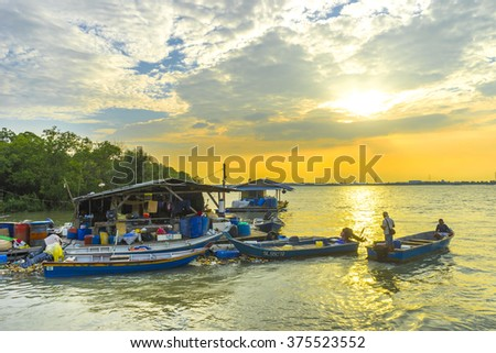 KLANG, MALAYSIA - FEBRUARY 08,2016 : Traditioal wooden fisherman boats park at the jetty with sunset background  - stock photo