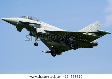 KLEINE BROGEL, BELGIUM - JULY 16: Royal Air Force Eurofighter Typhoon arriving after a mission during the COMAO exercise on July 16, 2007 in Kleine Brogel, Belgium - stock photo