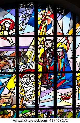 KLEINOSTHEIM, GERMANY - JUNE 08: Nativity Scene, stained glass window in the Saint Lawrence church in Kleinostheim, Germany on June 08, 2015. - stock photo