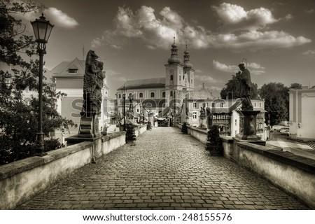KLODZKO, POLAND - MAY 20, 2014: St. John Bridge in Klodzko. This is gothic and historic stone bridge over a river in Klodzko in Lower Silesia. - stock photo