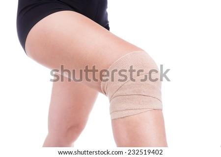 Knee injury, bandaged an elastic bandage. - stock photo