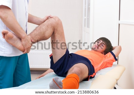 knee of injured football player - stock photo