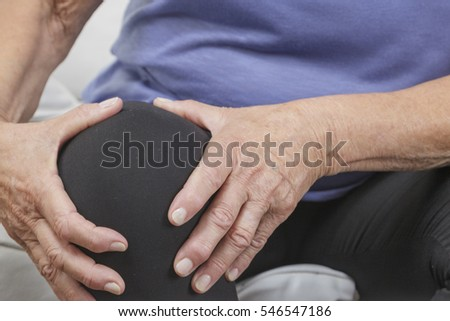 Knee pain of older woman closeup