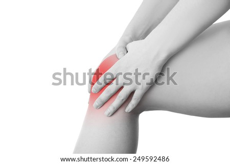 Knee pain of the woman isolated on white background. - stock photo