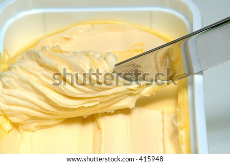 Knife and butter - stock photo