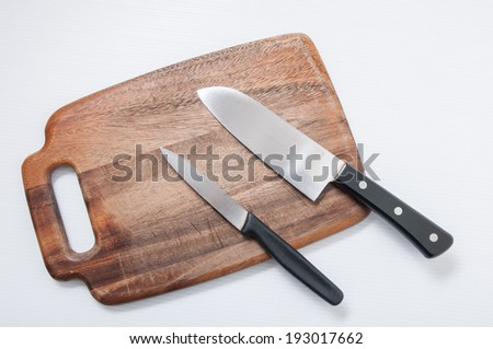 knife and cutting board - stock photo