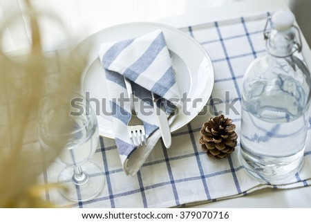 knife and fork at napkin on table, - stock photo
