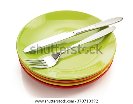 knife and fork at plate isolated on white background - stock photo