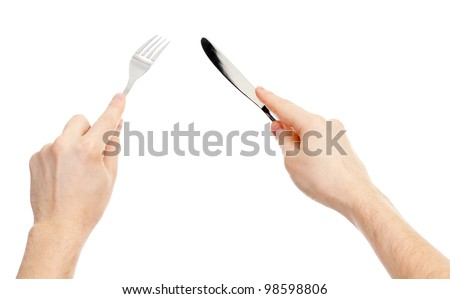 knife and fork cutlery in hands isolated - stock photo