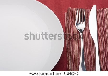 Knife and fork on a napkin as a dining room serving. - stock photo