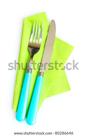 knife and fork on a napkin isolated on white - stock photo