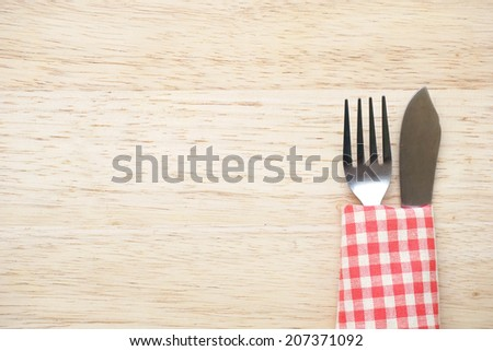 knife and fork on table - stock photo