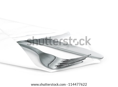 Knife and fork with linen serviette on white - stock photo