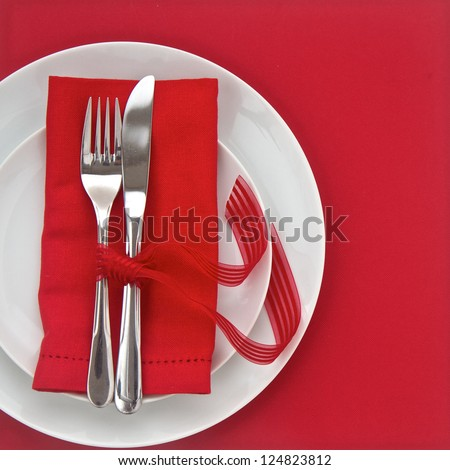 Knife and Fork with pink table setting  for Valentines Day - stock photo