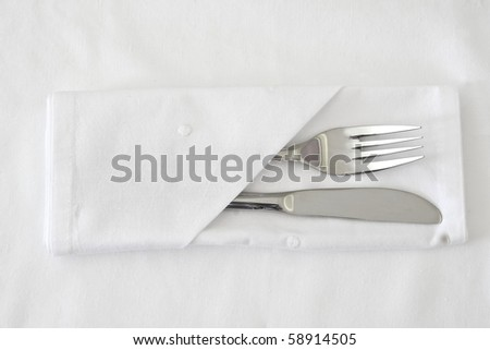 Knife and Fork with white table linen - stock photo