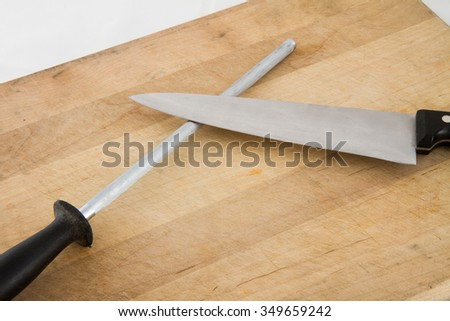 Knife and honer ready to do some cutting in the kitchen - stock photo