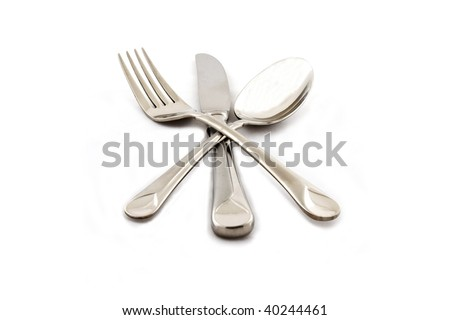 Knife, fork and spoon crossed together