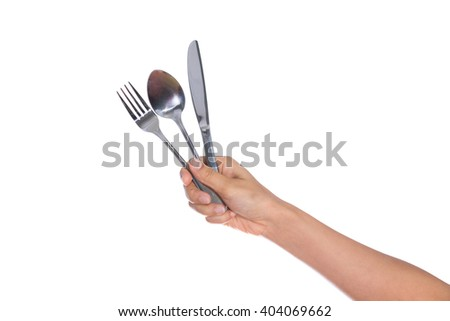 knife, Fork and spoon held by a woman's hands isolated over white background - stock photo