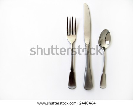 Knife fork and spoon silverware with white background