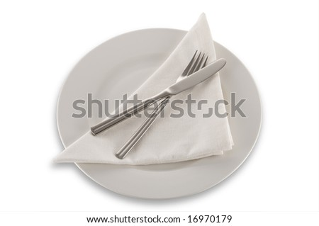 knife fork napkin and plate isolated on white with clipping path