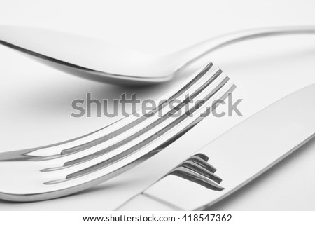 Knife fork spoon detail over a white background. Cutlery. Horizontal - stock photo
