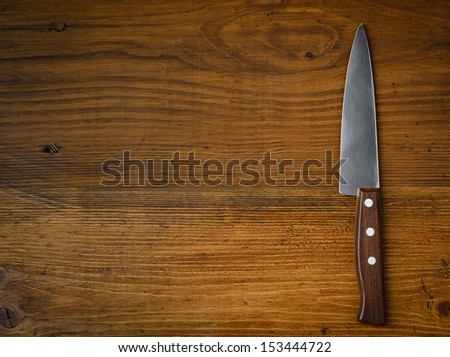 Knife on rustic kitchen table with copy space
