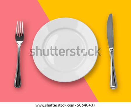 Knife, plate and fork on colorful background - stock photo