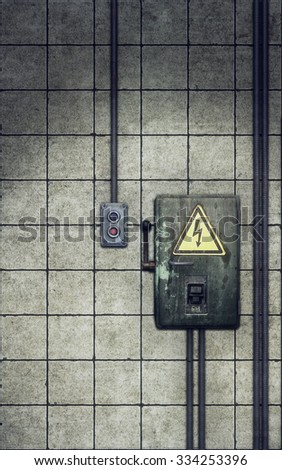 Knife switch on old dirty wall background - stock photo