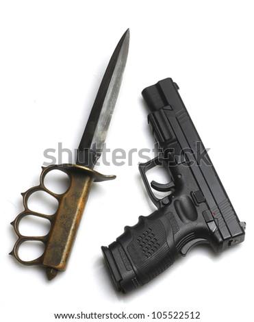 Knife to a Gunfight?/Automatic pistol arrayed next to Great War Trechknife - stock photo