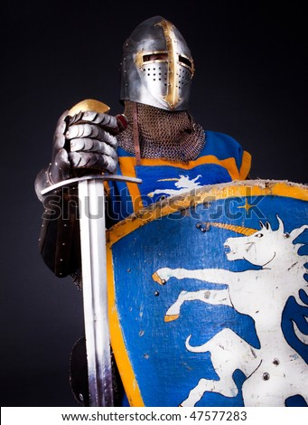 Knight holding his sword and shield - stock photo