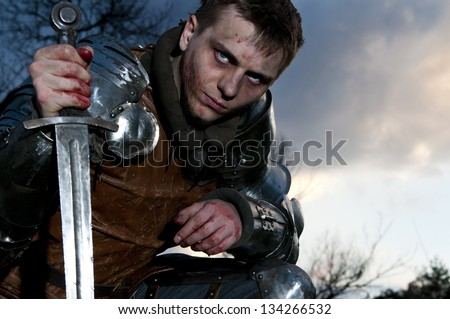 Knight holding his sword. Survived - stock photo